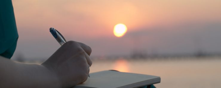 photodune-5834565-woman-writing-in-her-diary-at-sunset-s