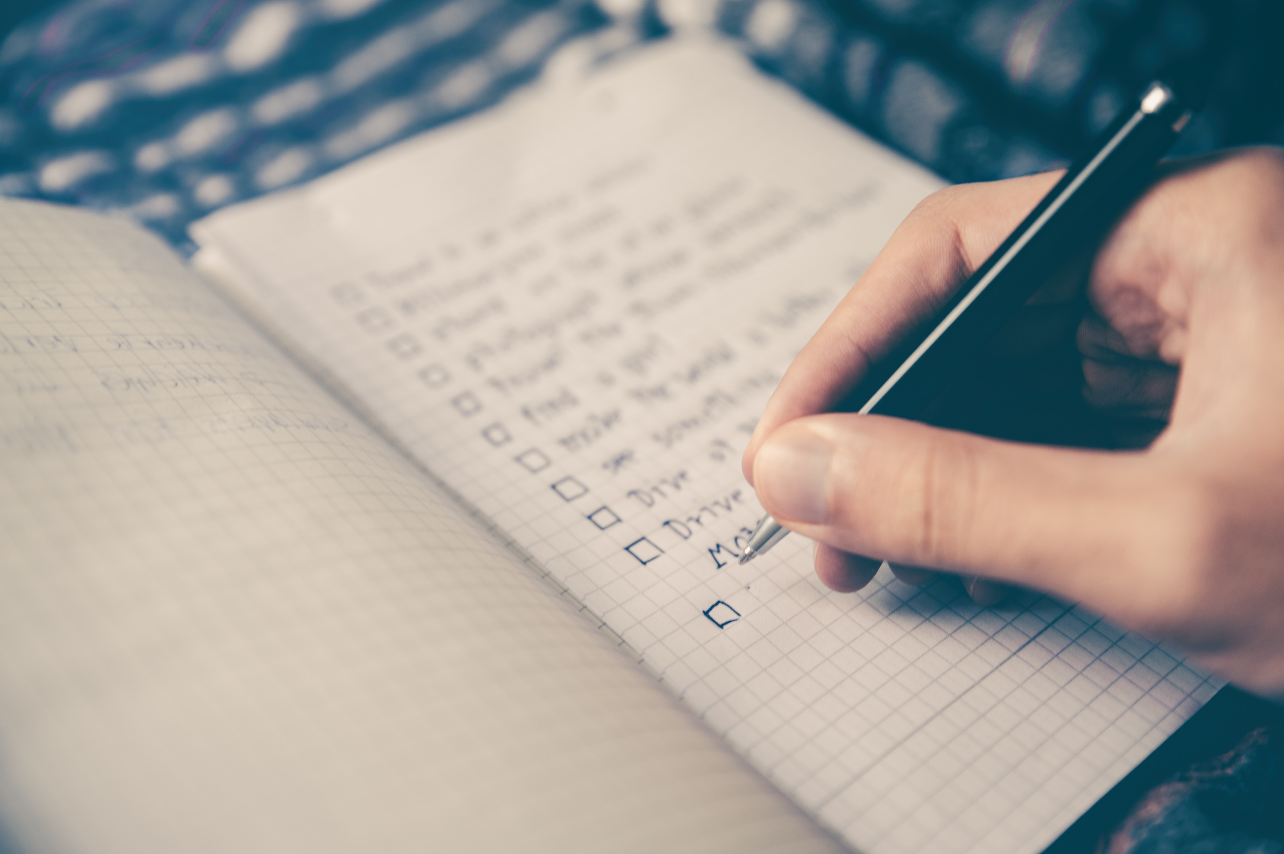 a person writing a checklist