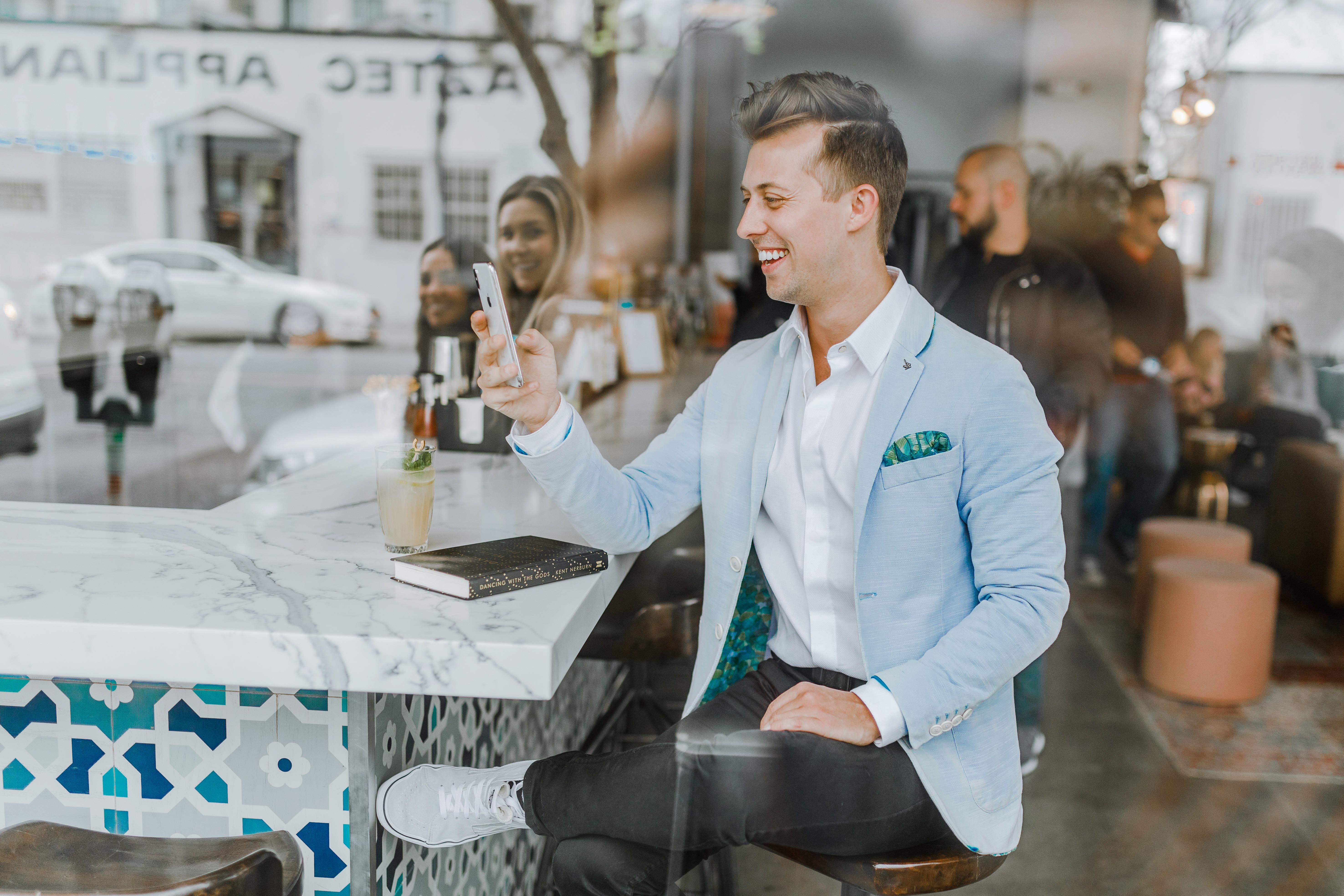 customer sitting at bar having a good time