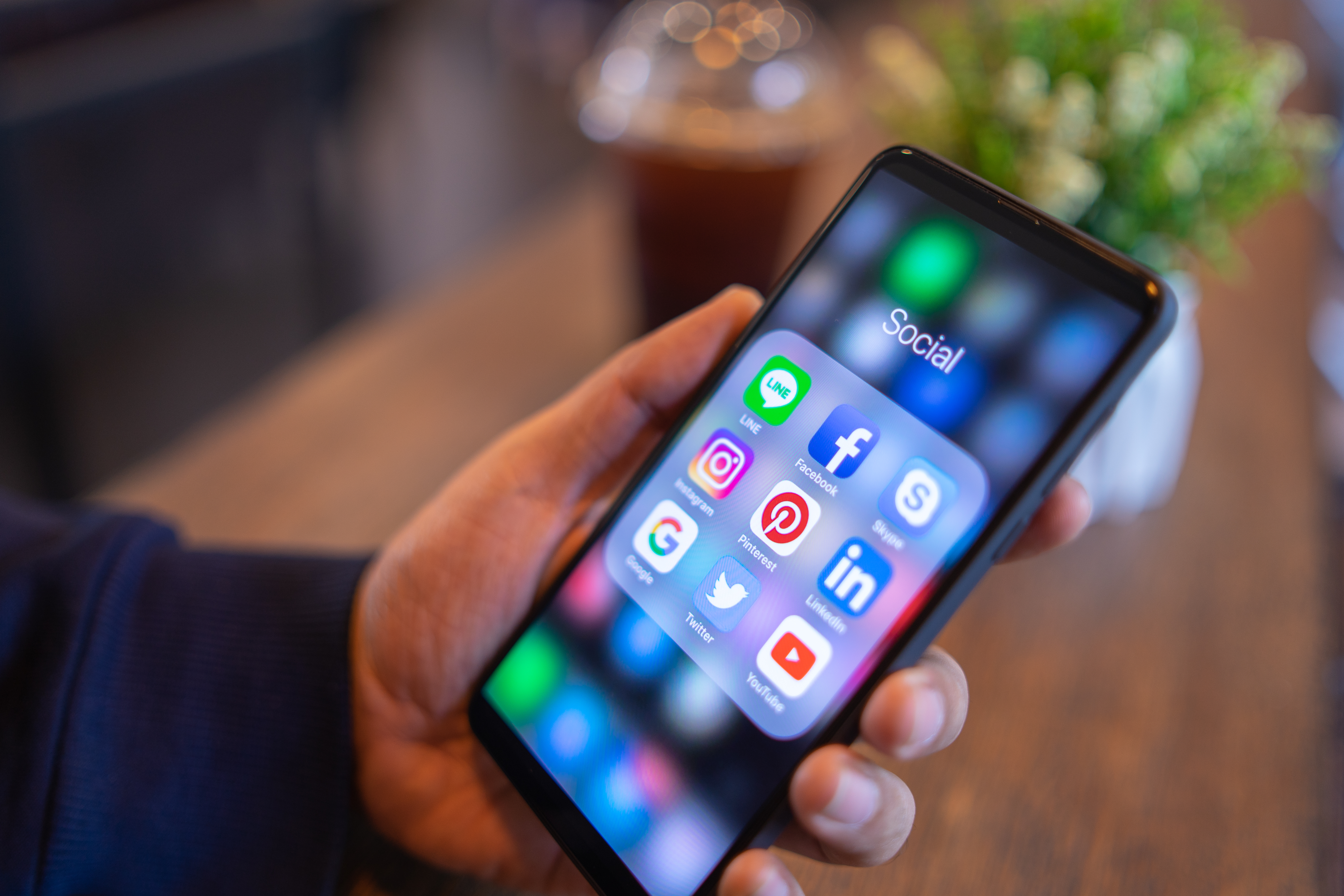 person holding checking their social media on their phone
